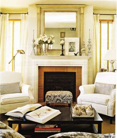 conversation area with bend and coffee table in front of fireplace.  Love light, relaxing colors and feel.