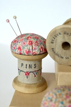 Handmade pincushion made from a wooden cotton reel / wooden bobbin / wooden spool decorated with applique and embroidery. This is a listing for a lovely handmade pincushion made using a vintage style wooden spool / cotton reel / bobbin. Decorated with applique bunting sewn using