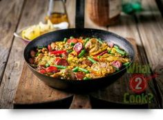 Chicken and Pork Paella, Garlic and Thyme | What2Cook