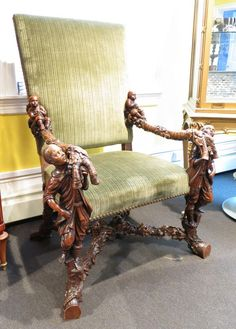 Pair of Carved Venetian Chairs A pair of ornately carved chairs in a colonial theme.