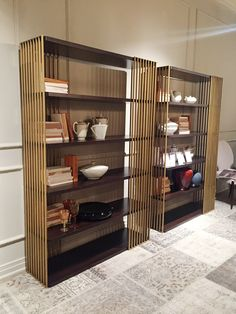 These Empire bookcases by Phillip Selva are handcrafted and feature beautiful vertical brass rails.