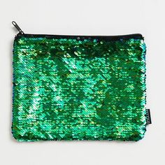 Magic sequined pouch looks like mermaid scales! Black sequins show when the pouch is brushed one direction and green/blue sequins show when the other side is revealed. Pouch has a zipper closure.<br><