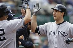 GAME 46: Saturday, May 26, 2012 - New York Yankees' Mark Teixeira, right, celebrates with Eric Chavez after hitting a solo home run off of Oakland Athletics pitcher Bartolo Colon during the fourth inning of a baseball game in Oakland, Calif. The Yankees won 9-2. (AP Photo/Jeff Chiu)