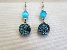 Check out this item in my Etsy shop https://www.etsy.com/listing/561779481/turquoise-dichroic-earrings-blue