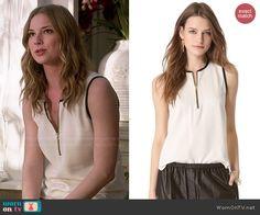 Emily's white zip front top with black trim on Revenge.  Outfit Details: http://wornontv.net/47149/ #Revenge
