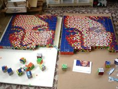 After coming across this art project using Rubik Cubes to create pixel art, we are pretty positive he have found the geekiest art form of all time. The inn