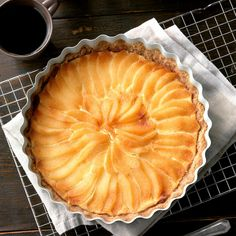 Pear Tart Recipe -My sister-in-law brought this pretty pastry to dinner one night, and we all went back for seconds. It is truly scrumptious. —Kathryn Rogers, Suisun City, California