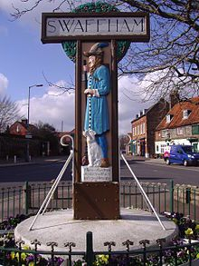 "Swaffham's name came from Old English Swǣfa hām = ""the homestead of the Swabians"" (ref to a region in Germany from which some Anglo-Saxons presumably came). The town sign references a folktale about a peddler."