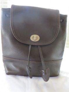 Buy Vintage Brown Leather Auth COACH Day Backpack by moodsoflife. Explore more products on http://moodsoflife.etsy.com