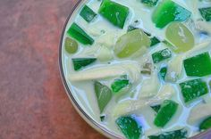 Buko Pandan Salad...gelatin cubes, fresh young coconut and tropical fruits in a pandan-infused cream http://www.kawalingpinoy.com/2013/05/buko-pandan-salad/
