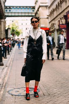 On the street at London Fashion Week Men's. #slipdress #redsocks #slides #blackslip
