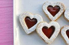 Linzer Cookies Ingredients  Dough:  2 ½ cups unsifted all-purpose flour  ½ cup unblanched almonds, finely ground  1 teaspoon ground cinnamon  pinch of salt  10 ounces (2 ½ sticks) unsalted butter, room temperature  2/3 cup granulated sugar  To decorate:  1 cup unsifted powdered sugar  2/3 cup raspberry jam  Method  Cream butter and granulated sugar until fluffy, about 3 minutes.  In a separate small bowl, combine the flour, ground almonds, cinnamon,  and a pinch of salt. Incorporate flour…