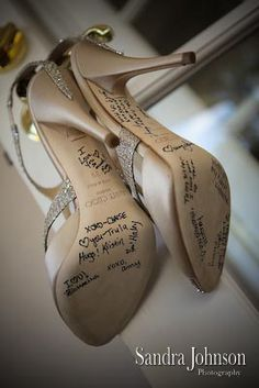Such a cute idea to have bridesmaids, mothers and grandmothers write messages on the bottoms of your wedding day shoes