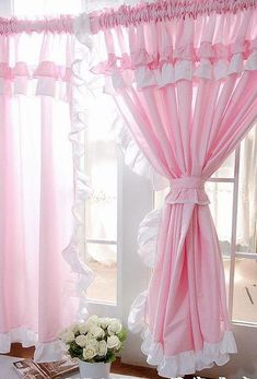 Pink ruffled curtains. So sweet!