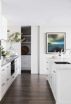 Home Interior Inspiration Lining boards on the walls in the kitchen add to the Hamptons vibe, while the sliding-door pantry offers discreet functionality. Kitchen On A Budget, New Kitchen, Kitchen Ideas, Kitchen Decor, Eclectic Kitchen, Kitchen Counters, Kitchen Cabinetry, Kitchen Inspiration, 10x10 Kitchen