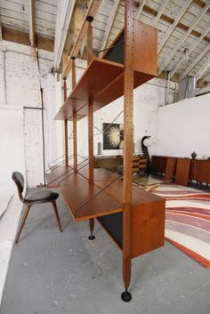 Rare Danish Modern Suspension Room Divider by Poul Cadovius | From a unique collection of antique and modern shelves at https://www.1stdibs.com/furniture/storage-case-pieces/shelves/