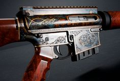 Engraved AR-15 with gorgeous acid/marble effects. Add a little class to your bad-ass.