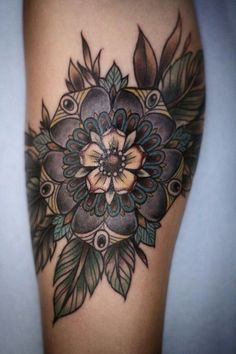 Flower leg tattoo - Okay, I have no idea what kind of a flower this one is, but I think it's cool with its darker shades. #TattooModels #tattoo