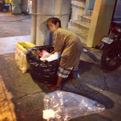 Every night, street children search through trash to find food & anything useable