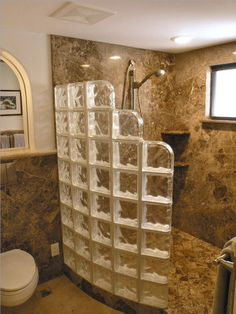 Look the shape... Use dark stone for the tile and where the glass is and you have yourself a shower in a cave! Walk In Shower, Glass Blocks, Mosaics, Glass