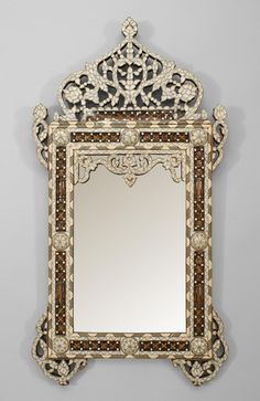 Middle Eastern Syrian (Moorish style, 20th Cent) wall mirror with inlaid mother of pearl, ebony and bone, with spindle and ball details.