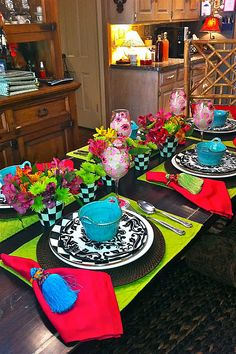 Mackenzie Childs table setting...just makes you feel happy!!