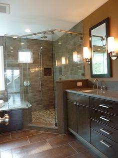 Corner Shower Design - Like the subway tile and floor in shower and wood tile