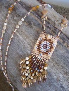This medicine bag is woven using peyote stitch-- one bead at a time--a very time consuming process.