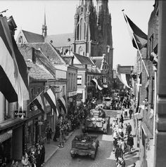 Eindhoven 17 - 18 September 1944: The people of Eindhoven line the streets of the town to watch armoured vehicles of British XXX Corps pass through. The 101st (US) Airborne Division had captured the town on the previous day.