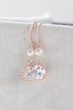 Rose gold and pearl earrings pink diamond pendant earrings diamond dangle earrings pink bridal jewelry pink prom jewelry rose gold wedding by ElegantAvenues on Etsy https://www.etsy.com/listing/266175306/rose-gold-and-pearl-earrings-pink