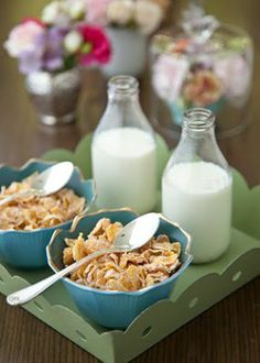 Easy peasy breakfast for two. So cute. Cornflakes and milk.