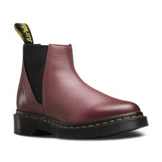 Echoing early 80's Gothic style of dainty ankle boots, the low height Bianca Chelsea Boot is new for this season. Burnished to give a two tone effect, the Antique Milled Brunido leather gives the boot an updated, premium feel. The front panel cleanly wraps around the toe from the throat, and side elasticated panelling offers ease of entry. Maintaining the classic Dr Martens trademarks, Bianca includes yellow Z-welt stitching, iconic tread pattern and heel loop. The bouncy Airwair sole is…