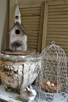love the chicken wire cloche and the sprin holding the nest