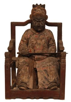 Rare Chinese hand carved wood Ming Dynasty Period polychromed temple guardian statue. Masterfully crafted throughout depicting temple guardian holding sword and seated on throne