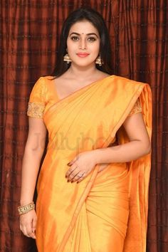 Poorna (Shamna Kasim) wore a bright yellow solid silk saree for the movie opening of 'Avanthika'. Considering the saree itself is very bright