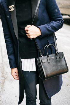 Chanel brooch | Saint Laurent sac de jour bag.