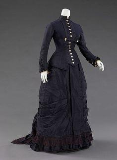 Dress Designer: Mrs. F. M. Carroll  Date: 1877 Culture: American Medium: silk, mother-of-pearl Accession Number: 2009.300.2432a, b