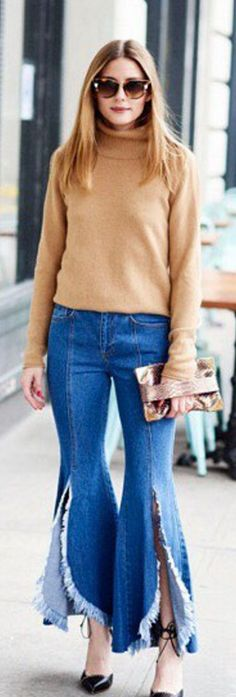 Who made Olivia Palermo's brown cat sunglasses and slit jeans?