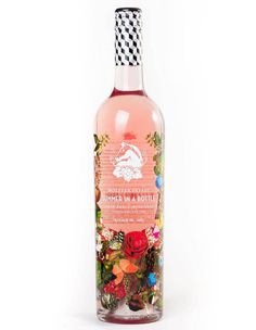 A bottle of rosé wine that looks like a piece of art.
