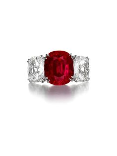 I don't know how much it costs, but they say if you have to ask, you can't afford it. Burmese Ruby and Diamond Ring by Siegelson, New York