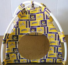 LSU Tigers Handmade Fabric Pup Tent Pet Bed. Avail @ http://stores.sharonsdecoratedbooks.com/ Beds r made when ordered and payment is received. The average time that it takes for the Bed to ship after payment is usually 5 biz days. The Pet Beds are made of licensed cotton NCAA College material, but are not licensed by the NCAA College. They are handcrafted and resold under rights granted by the 1st sale doctrine. We are not affiliated with The Licensed Company in any way. ***22$ Sm  27$ Lg