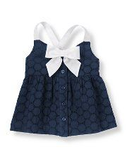 Bow Eyelet Top  Lovely bow top with circle patterned cotton eyelet for summery style. Front button placket and shirring complete the airy design. 100% Cotton Eyelet Front Buttons Machine Washable; Imported Sizes 7 To 12 Online Only Sunny Stroll Color : Marine Navy $34.00 now $20.99 Item #100019201