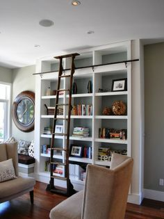 Figuring out what to do with my new built-in shelves and library ladder