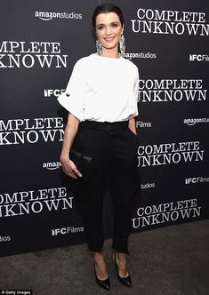 Fancy: The 46-year-old looked chic in a white blouse tucked into high-waisted…