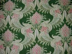 Art Nouveau pattern has pink lotus flowers with scrolling leaves, ca. 1900.