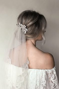wedding hairstyles with veil simple low updo with veil and silver flower hairpin. - wedding hairstyles with veil simple low updo with veil and silver flower hairpin untamedpetals - Wedding Hairstyles With Veil, Short Wedding Hair, Wedding Hair Down, Hair Comb Wedding, Wedding Hair And Makeup, Wedding Veils, Down Hairstyles, Wedding Dresses, Wedding Hair With Veil Updo