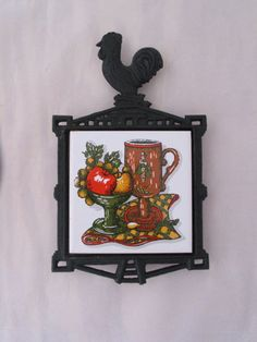 Black Cast Iron Wall Hanging Tile Trivet with by FoxyFineVintage