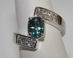 Alexandrite: AGL Certified 2.42ct Natural Alexandrite and Diamond Custom Ring. $21,400.00, via Etsy.