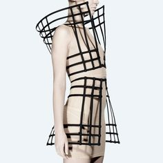 The Chromat Asteroid Vest is a gridded cage top with a standing collar. The Asteroid Vest is made of boning with a metal hook closure at center front. Available in black, white. This piece is part of Geometric Fashion, 3d Fashion, Fashion Details, High Fashion, Fashion Show, Fashion Design, Structured Fashion, 3d Mode, 3d Laser