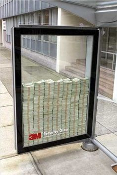 This security glass in placed in a busy city and filled with lots of cash. It's trying to convey how strong the glass is as money is left inside the glass unattended. If anyone tried to break in they would be unsuccessful as the glass is that strong, I really like this idea.